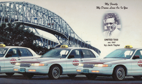 Taxis near a bridge